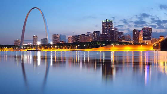Saint Louis arch and skyline reflecting on the Mississippi river