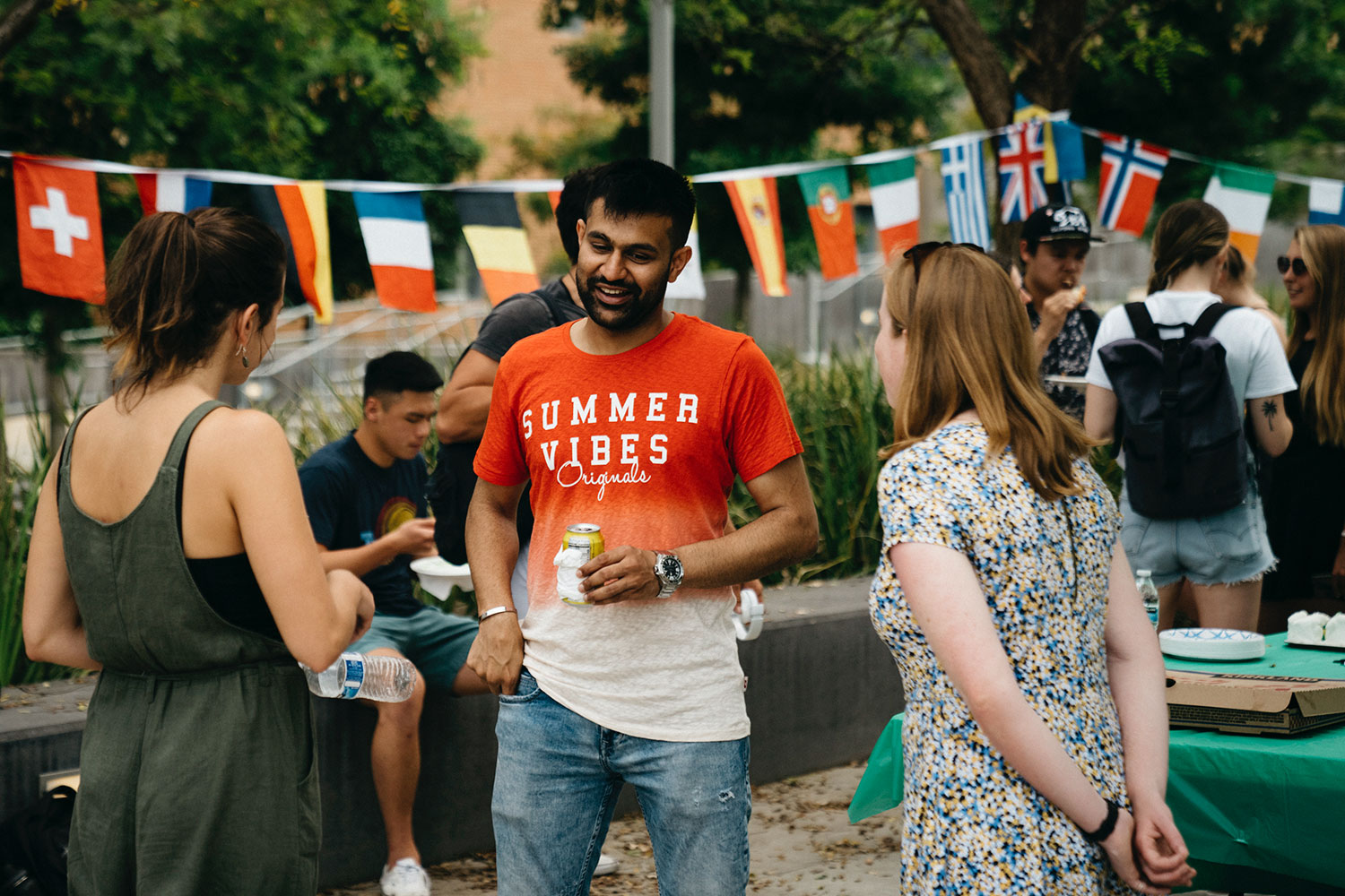 students chat while at an international center function outside