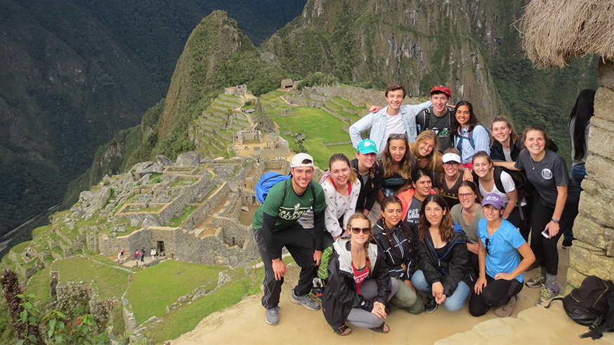 cal poly study abroad students above ruins